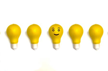 Yellow lighting lamp, isolated on white background, energy concept