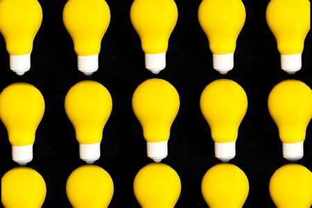 Yellow lighting lamp, isolated on white background, energy concept, idea and creativity. 스톡 콘텐츠