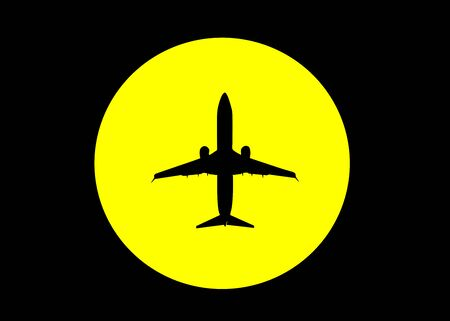 black silhouette of the plane against the yellow sun in the black sky 免版税图像