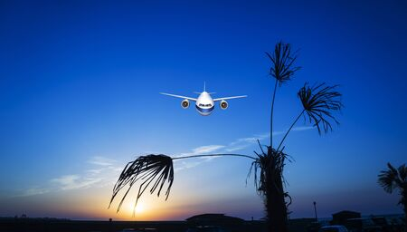 passenger plane fly up over take-off runway from airport at sunset, sunrise. Stock fotó