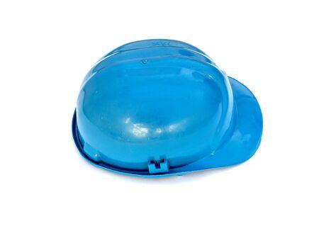 Plastic blue safety helmet over white background