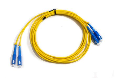 Yellow wire cable with the blue end caps on a white background Stock fotó