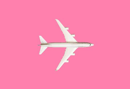 Model plane, airplane on pink pastel color background with copy space.Flat lay design.Travel concept on pink background. top view model plane on pink color background