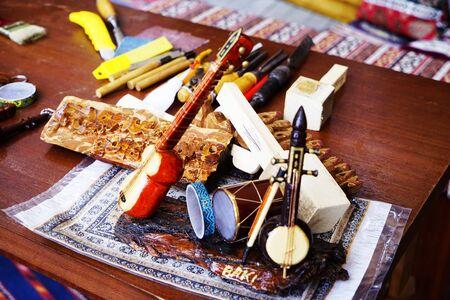 Souvenir mugam musical instrument tar. National folk musical instrument of Azerbaijan. String wooden instruments - tar. Souvenir of Azerbaijan. Isolated musical instrument on wooden background.