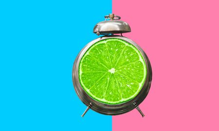 Summer time concepts idea with alarm clock on colorful background.holiday decoration images