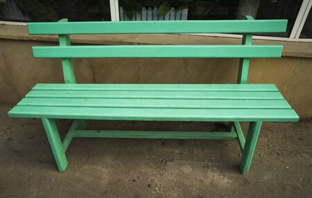 wooden park bench at a park.