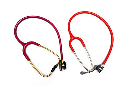 Red stethoscope on a white background.Concept of medicine and health.