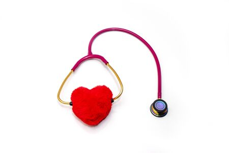 Red stethoscope and red heart on a white background.Concept of medicine and health.