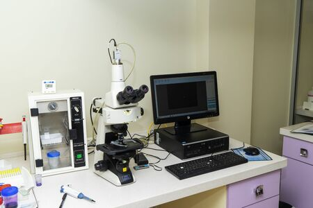 Microscope, a computer for blood and semen analysis in the laboratory.