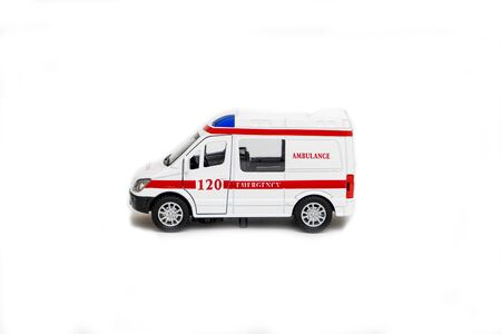 Ambulance toy car on a white background. Concept of medical care and health