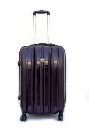 Black plastic travel suitcase on wheels on a white background. Concept of tourism and travel.
