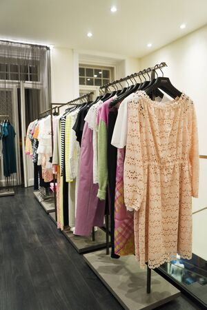 colorful Women's dresses on hangers in a fashion store. Shop stylish clothes, close-up. - image Banque d'images