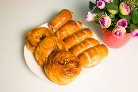 a variety of bakery on wooden plate