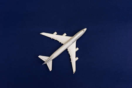 Passenger Model airplane on a blue background. Free space for text Reklamní fotografie