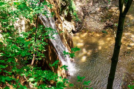 Beautiful waterfall of the Caucasus Mountains, stormy mountain water. Azerbaijan