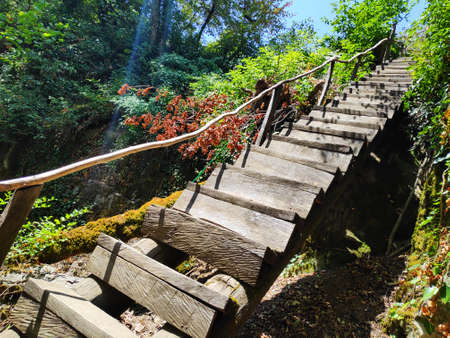 An old homemade wooden staircase in the Caucasus mountains. Azerbaijan Zdjęcie Seryjne