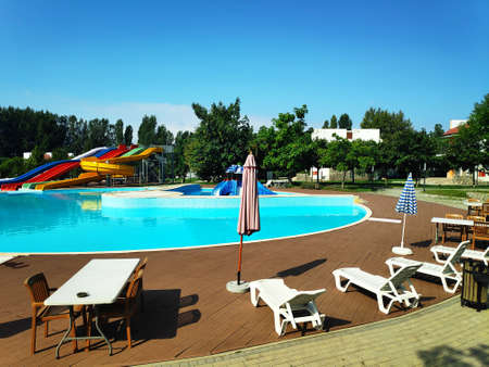 Water Park, swimming pool, sun beds, umbrellas among green trees
