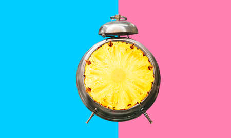 Summer time concepts idea with alarm clock on colorful background.holiday decoration images.