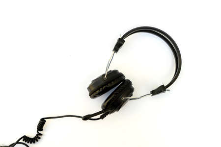 Black stereo headphones with microphone on white background.