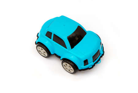 Childrens toy car made of blue plastic on a white background