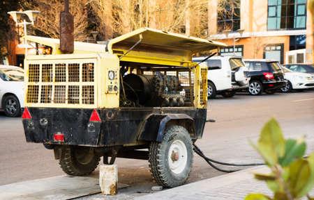 diesel electric generator standing in the street Standard-Bild