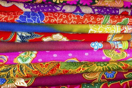 sarong: Colorful pile of batik fabrics or textiles Stock Photo