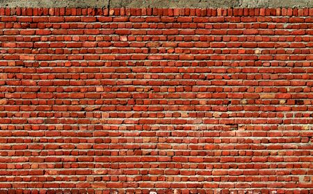 Red Brick Wall Closeup Background Фото со стока