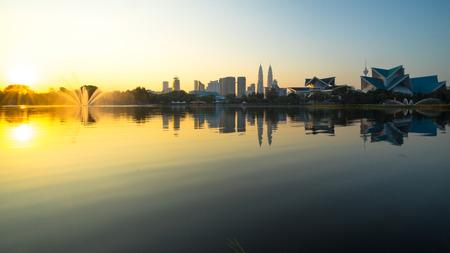 titiwangsa: KUALA LUMPUR, MALAYSIA - FEBRUARY 20, 2015: Sunrise view of Kuala Lumpur at Lake Titiwangsa, Malaysia.The lake is located just beside the busy Jalan Tun Razak in the heart of Kuala Lumpur, Malaysia.