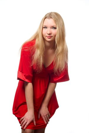 Portrait of young woman in red dress. Studio shot. White background.