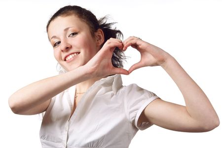 Portrait of young girl showing heart with her hands. White background. Studio shot. photo