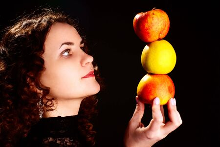 Portrait of a young beautiful woman with apples. Studio shot.