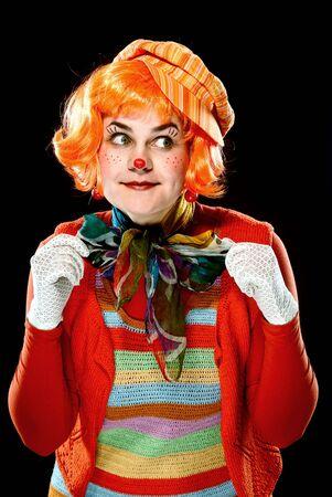 Portrait of a smiling clown. Studio shot. Black background
