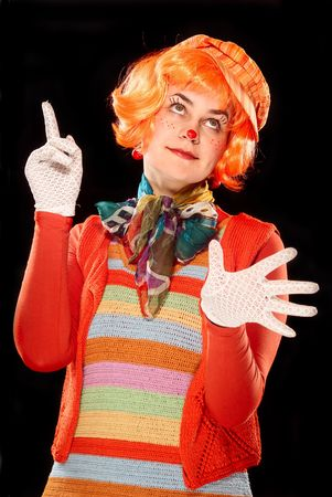 Portrait of a clown. Blsck bsckground. Studio shot. photo