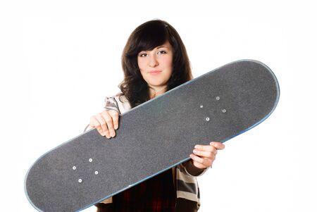 Teenage girl with skateboard. White background. Studio shot. photo