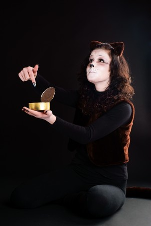Portrait of a cat girl with an empty can. Studio shot.