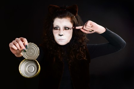 Portrait of cat-girl with an empty can. Studio shot. Stock Photo