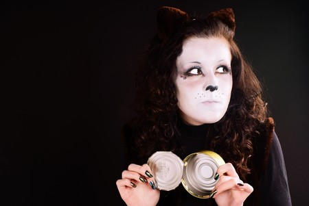 Portrait of a cat-girl with the can. Studio shot.