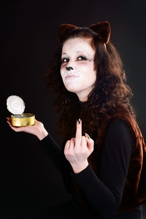 Cat-girl with can showing middle finger. Stock Photo - 7174252
