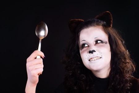 Portrait of cat-girl with spoon. Studio shot. Stock Photo - 7174261