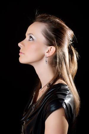 Portrait of a beautiful woman. Black background. Studio shot.