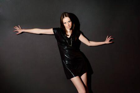 Portrait of a woman on a dark background. Studio shot. Stock Photo - 7656367