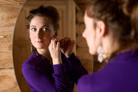 Portrait of a beautiful woman in front of mirror.