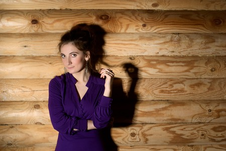 Beautiful young woman standing at the wall. Stock Photo