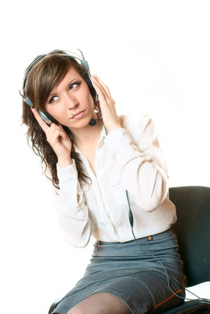 Bussiness woman with headphones. Studio shot. White background. photo