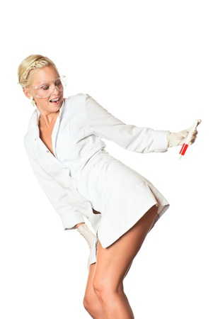 Sexy woman in white coat making injection to herself. White background. Studio shot.