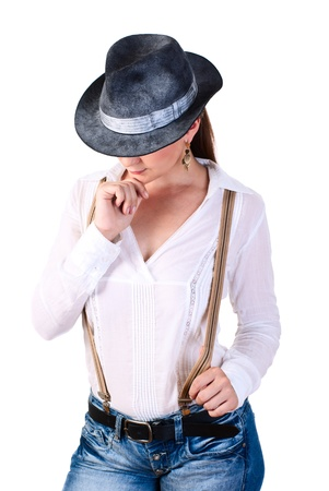 Young sexy cowboy woman. White background. Studio shot.