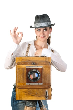 Young sexy woman with an old photo camera. White background. Studio shot. Stock Photo - 8493008