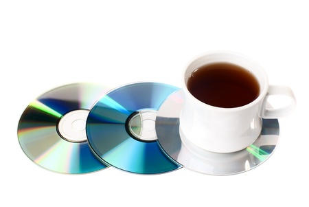 A cup of tea on CD disks. Isolated on white background. Stock Photo - 8803298