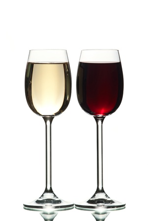 Two wine glasses filled with wine.