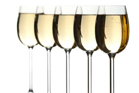 Five wineglasses filled with white wine. Stock Photo - 8803426